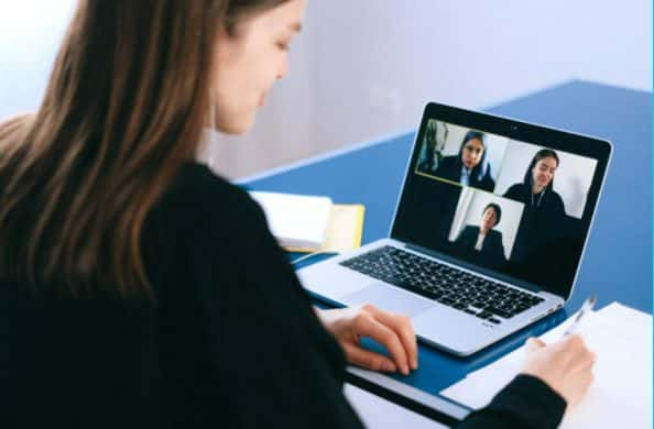 Image of person looking at video screen on a virtual conference