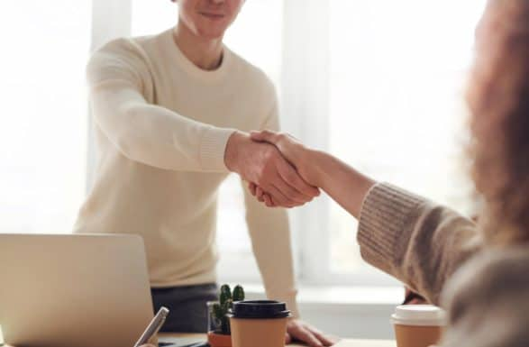 Image of two people shaking hands at a job interview