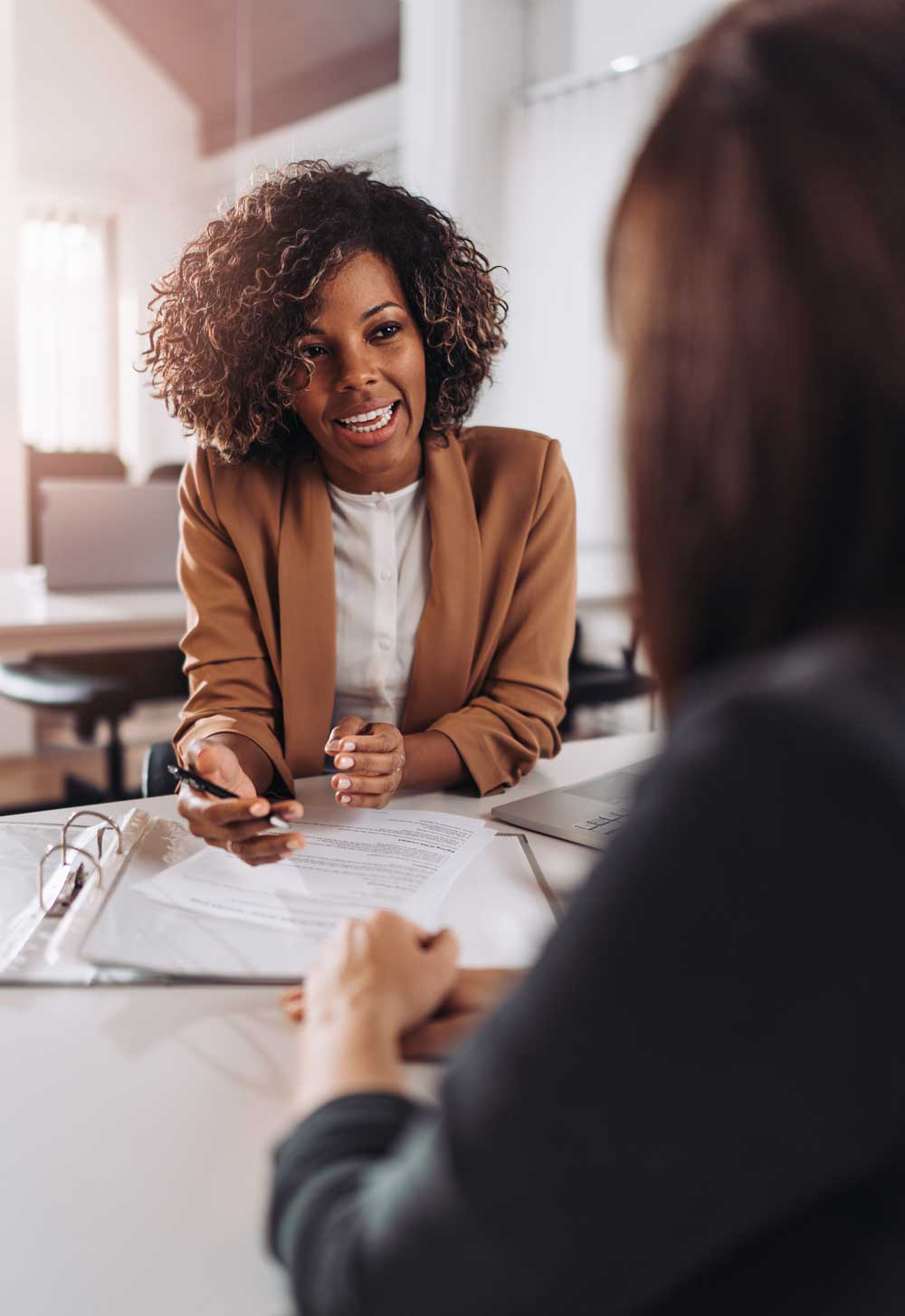 A women interviews a candidate for a foundation job